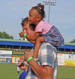 A little girl gets a bird's eye view of the play area at Whitaker Bank Ballpark.
