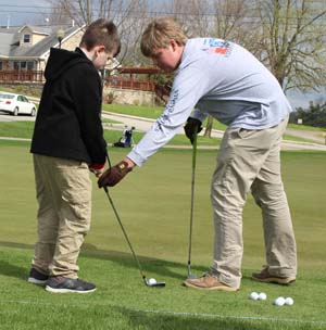 High school players mentor the Deep Springs kids on the golf course.