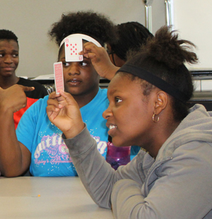 Students use playing cards in math drills.