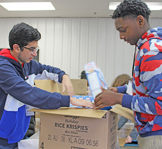 Students repacked boxes of Rice Krispies for distribution to families in need.