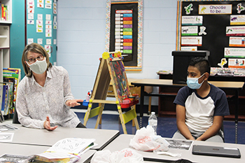 EL teacher Margaret Hayes works with a student from Nepal in Lansdowne's Refugee Outreach Club