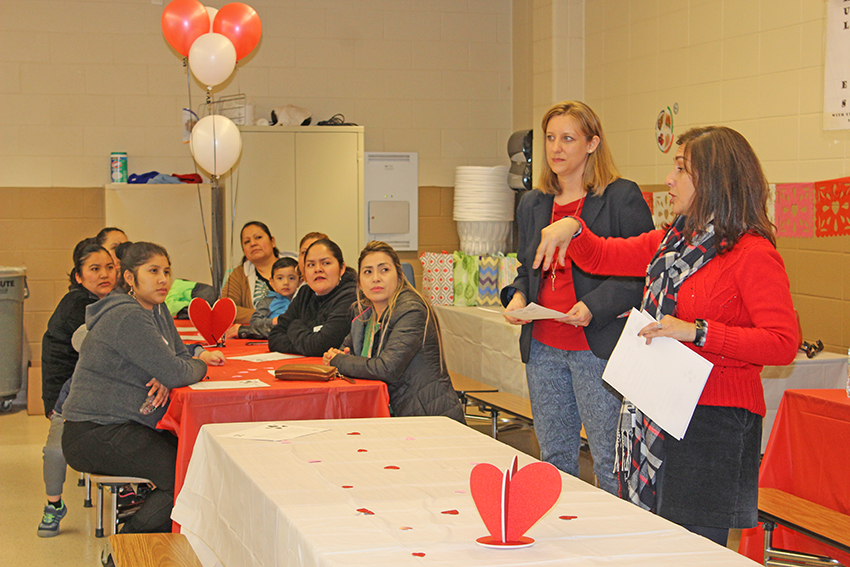 FRC coordinator Beth Myers and EL advocate Norma Flores welcomed families for the Valentine's party