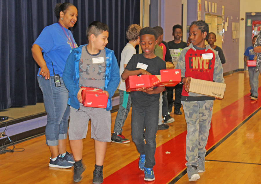 Students were excited to receive new sneakers.