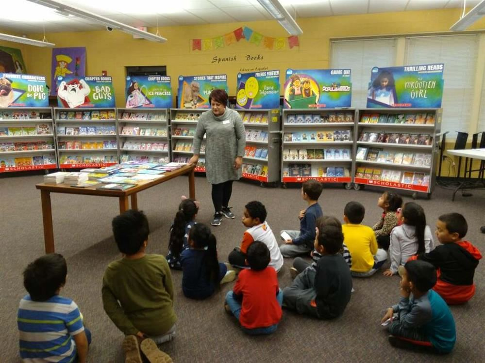 Students learning about the free books