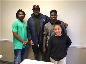 Adrian Gonzalez Lazo (center) poses with student interviewers Diajawan Williams, Jajuan Stevens, and Maria Ramirez Cruz.
