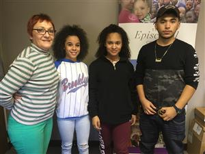 Dragana Zaimovic stands with student interviewers Talaya Thurman, Tedi Hawkins, and Chris Paz Vasquez.