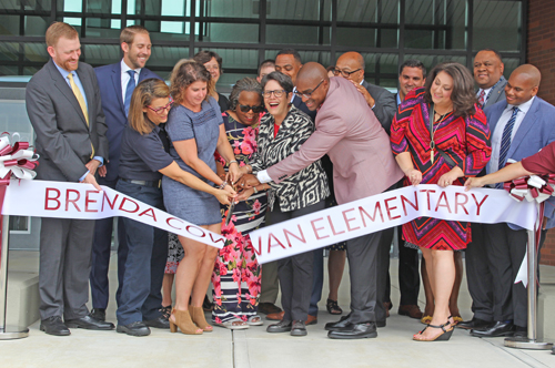 Group gathers to cut the ribbon and officially open the school (Aug. 12, 2019)